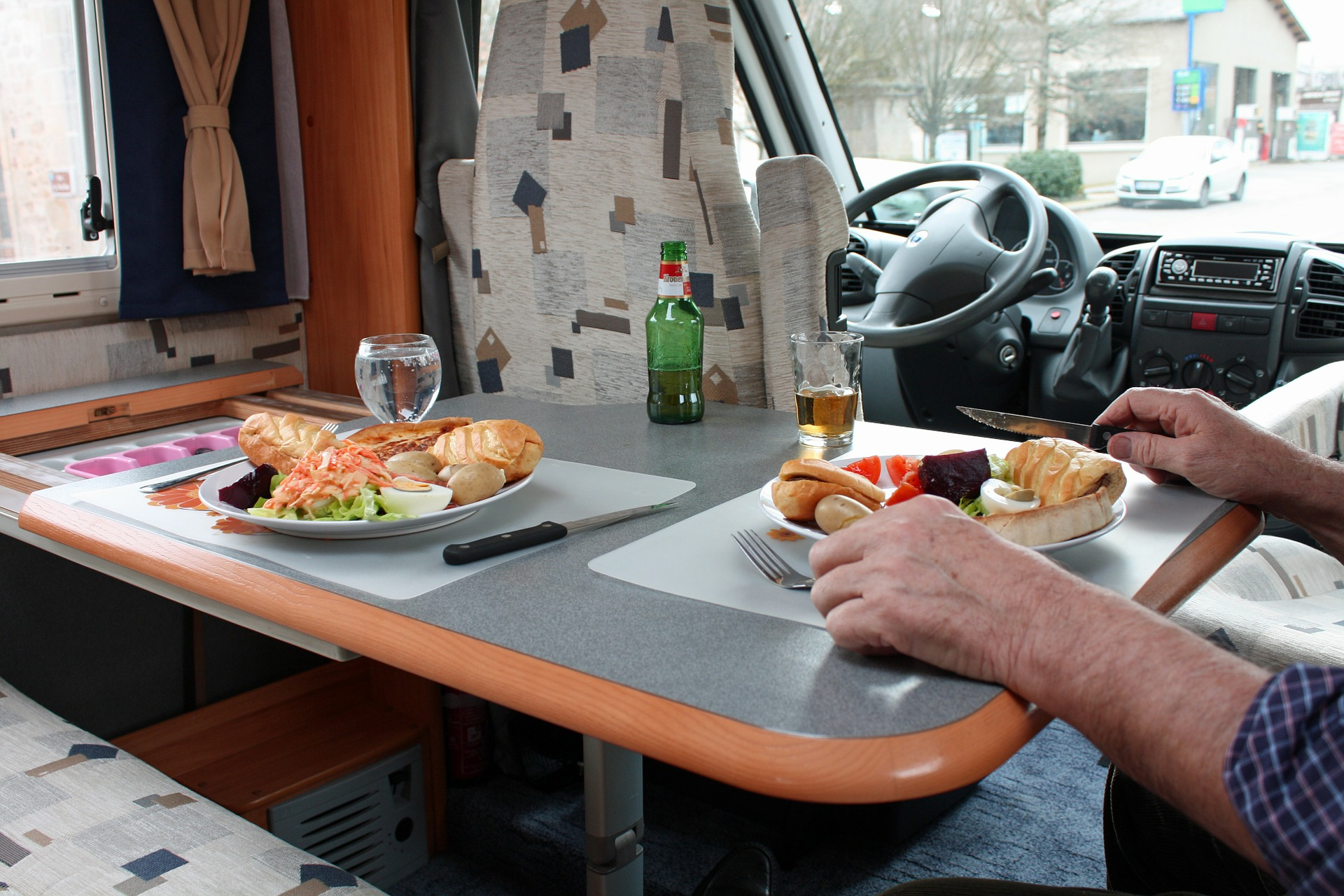 a meal set up in the interior of a camper van